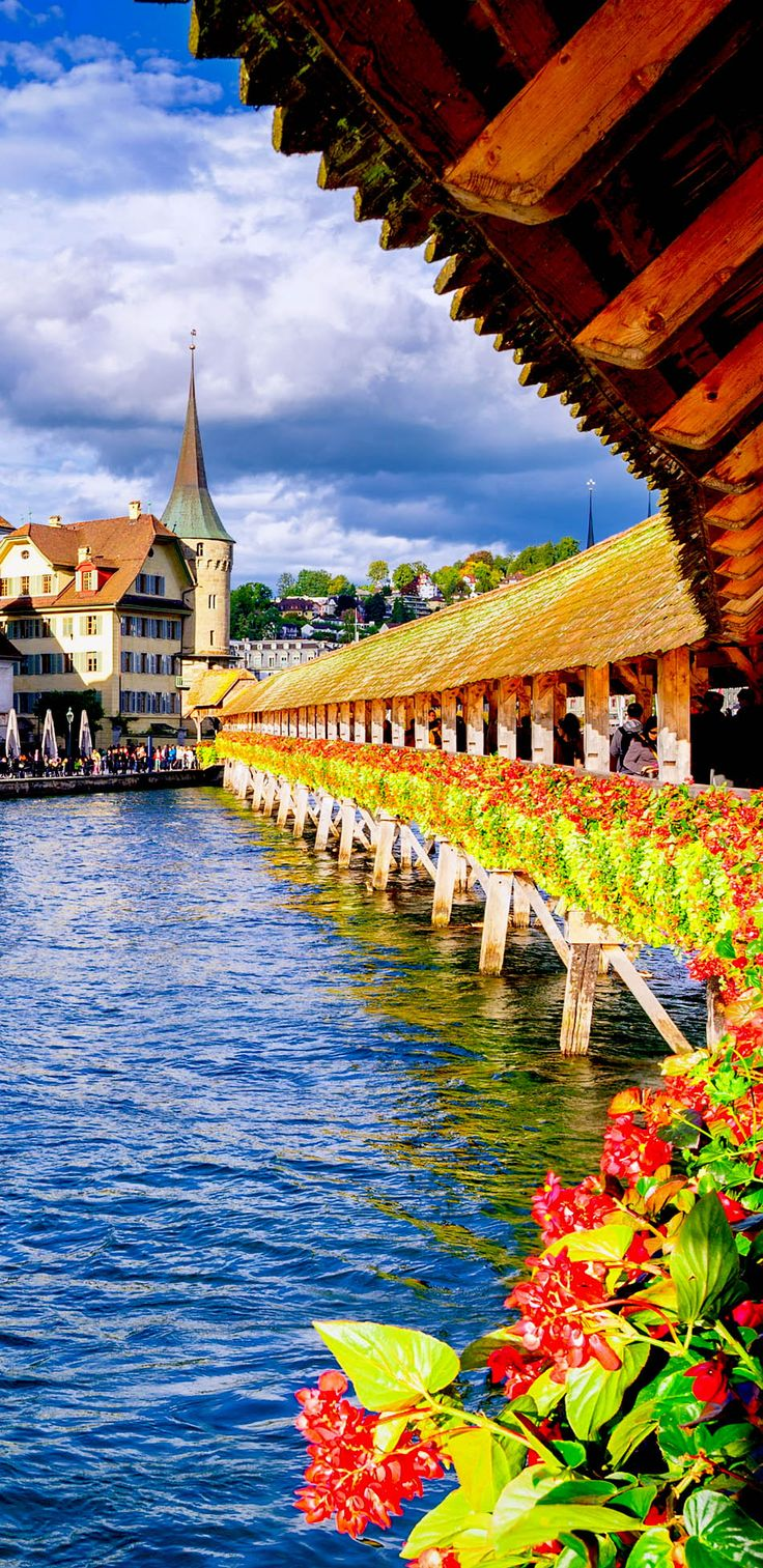 View on the old city of Lucerne, from the famous Chapel Bridge, a wooden bridge erected in the 14th century, one of Switzerland's main tourist attractions and the oldest covered bridge in Europe.