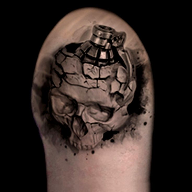 Skull grenade realistic tattoo done in black and grey by Brandon Marques. Timeless Tattoo Studio, Toronto, ON. For appointments and info visit our website or email: info@timelesstattoos.ca.