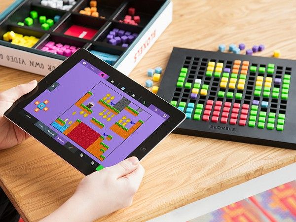 Kids design their own video games—with physical blocks on the game board. Then the app brings their creations to life on the screen.
