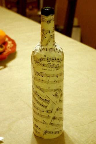 How to sheet music a wine bottle. Would make a gorgeous vase...with a few pink peonies this would make a beautiful centerpiece!!