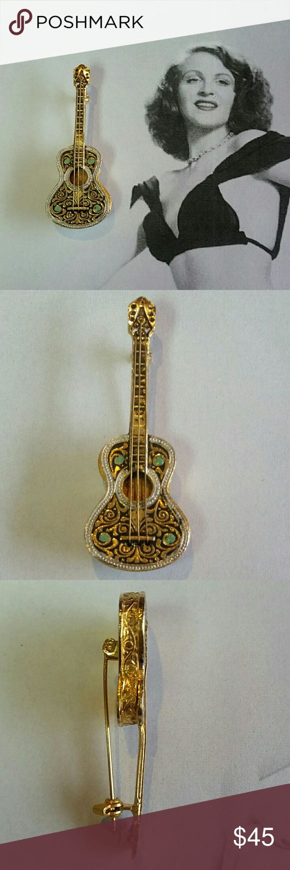 "Vintage Toledoware damascene guitar brooch Vintage Toledoware Damascene acoustic guitar brooch. Measures .75"" wide and 2"" long. Has green enamel applied to 4 points on guitar face. Detailed scrollwork on face of guitar and sides. Excellent vintage condition. Reasonable offers accepted. Add to a bundle and I will offer you my best price. :) Vintage Jewelry Brooches"