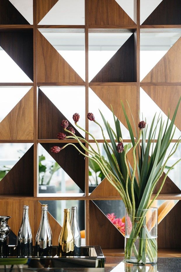 Love this combination wall panelling with Elm and Walnut triangles combined with mirrored triangles.