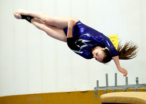 AIRBORNE – Fayne O'Donovan (Polarettes) flies through the air after launching off the vault. [Whitehorse Star]