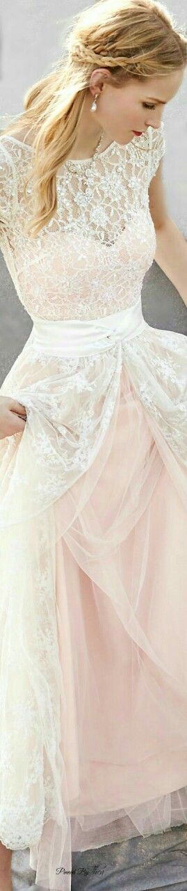 A whimsical wedding dress featuring lace and sparkly embellishments - we love it!