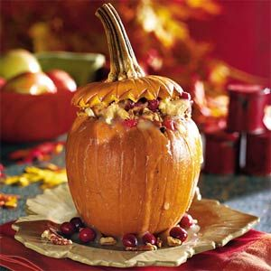 Gorgeous for Thanksgiving! Stuffed Pumpkin with Cranberry-Raisin Bread Pudding #savory #fall