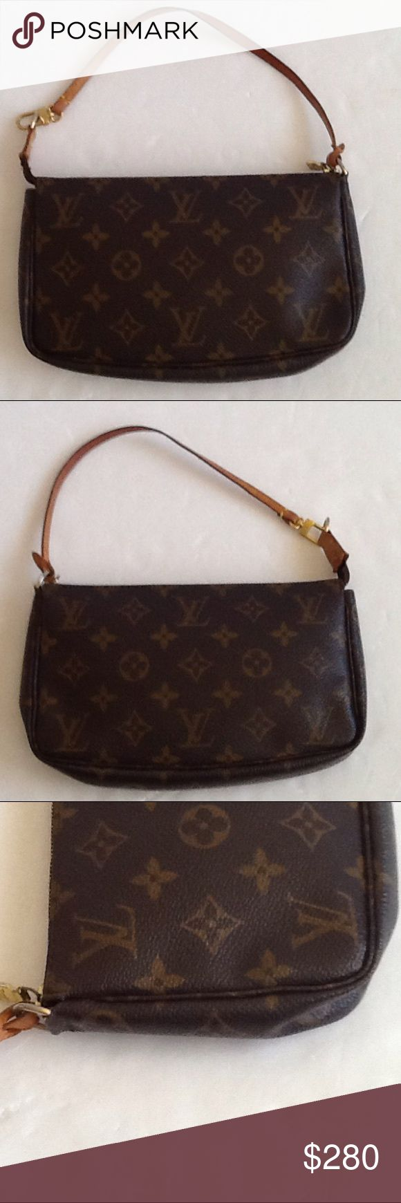 Authentic Louis Vuitton Monogram Pochette Bag. The handle showed signs of used. The date code is VI 0022. The canvas and inside linen are good. The dimension is 8, 5 and 1. Over all the bag us in a good condition. Louis Vuitton Bags Clutches & Wristlets