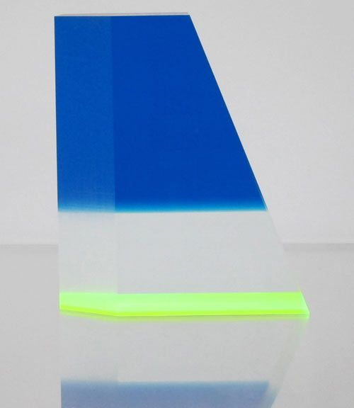 Manhattan-based artist Phillip Low creates these one-of-a-kind acrylic sculptures in various shapes, sizes, and colors. The pieces are made from sheets of colored acrylic laminated onto large blocks of acrylic that are then milled into geometric shapes.