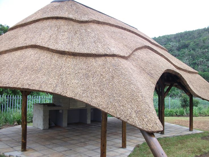 Large covered space outside that is finished with the installation of a braai and tiles on the ground - a smart way to finish off any thatched lapa