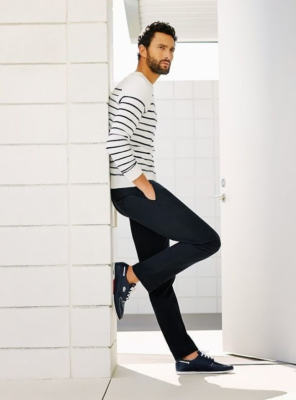 Shop this look on Lookastic:  http://lookastic.com/men/looks/white-and-black-horizontal-striped-crew-neck-sweater-navy-chinos-navy-leather-low-top-sneakers/6309  — White and Black Horizontal Striped Crew-neck Sweater  — Navy Chinos  — Navy Leather Low Top Sneakers