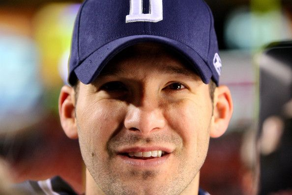 Tony Romo Photos Photos - Tony Romo #9 of the Dallas Cowboys looks on during an interview after the game against the Washington Redskins on November 16, 2008 at FedEx Field in Landover, Maryland.  The Dallas Cowboys won 14-10 over the Washington Redskins. - Dallas Cowboys v Washington Redskins