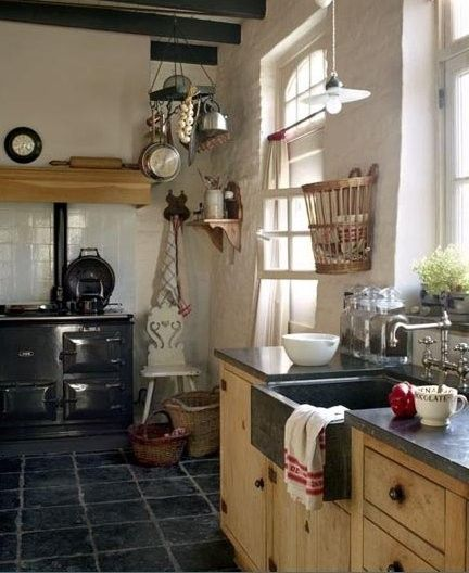 the floor, white tile walls, rough hewn lower cabinets and counter top & sink. Truly enjoy the absence of upper cabinets.