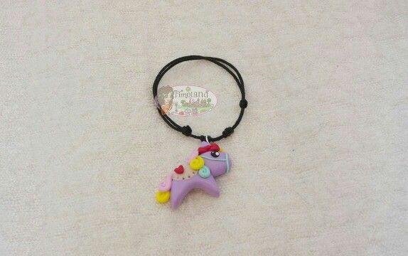 Braccialetto regolabile con cavallo multicolore realizzato a mano in Fimo by fimoland