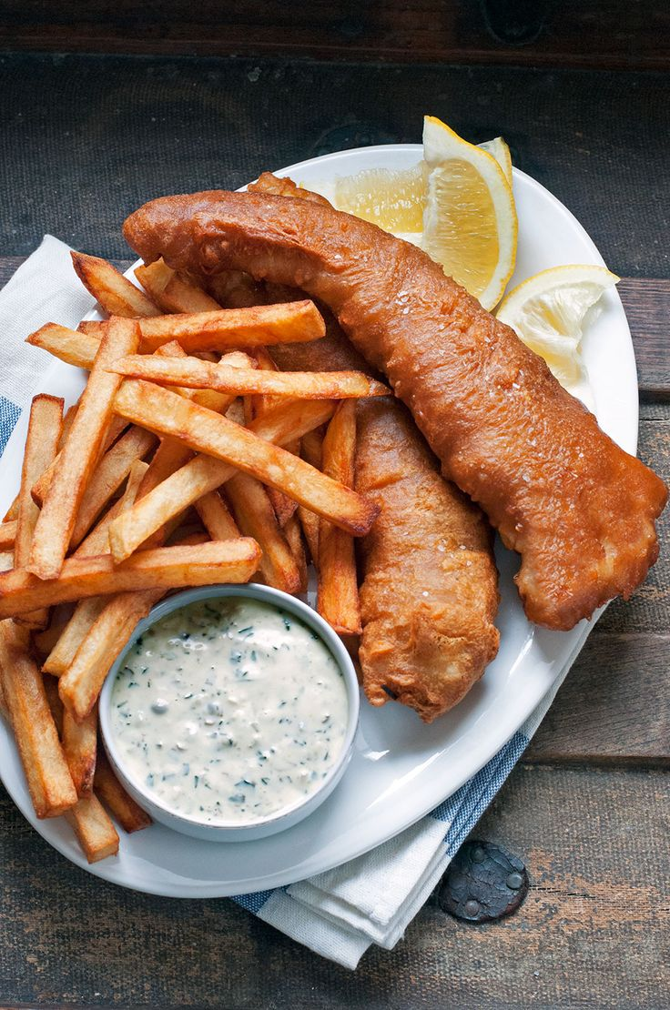 Pub-Style Fish & Chips By Andrew Zimmern.  This simple comfort food classic always hits the spot. Serve with my homemade tartar sauce, plenty of lemon wedges and malt vinegar.