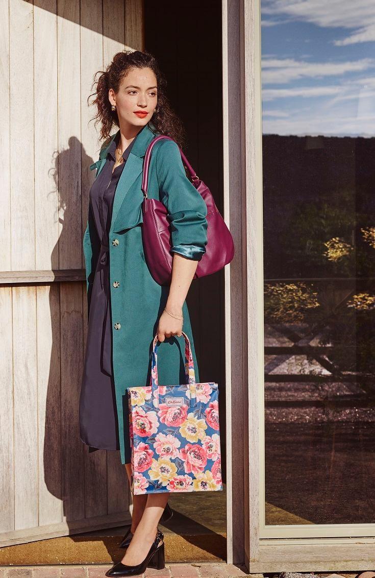 Brighten up your outfit with this Peony Blossom bag, decorated in bold primary colours and finished in shiny oilcloth that's easy to wipe clean. A zip fastening keeps your essentials safe, while an internal hanging pocket is ideal for organising.