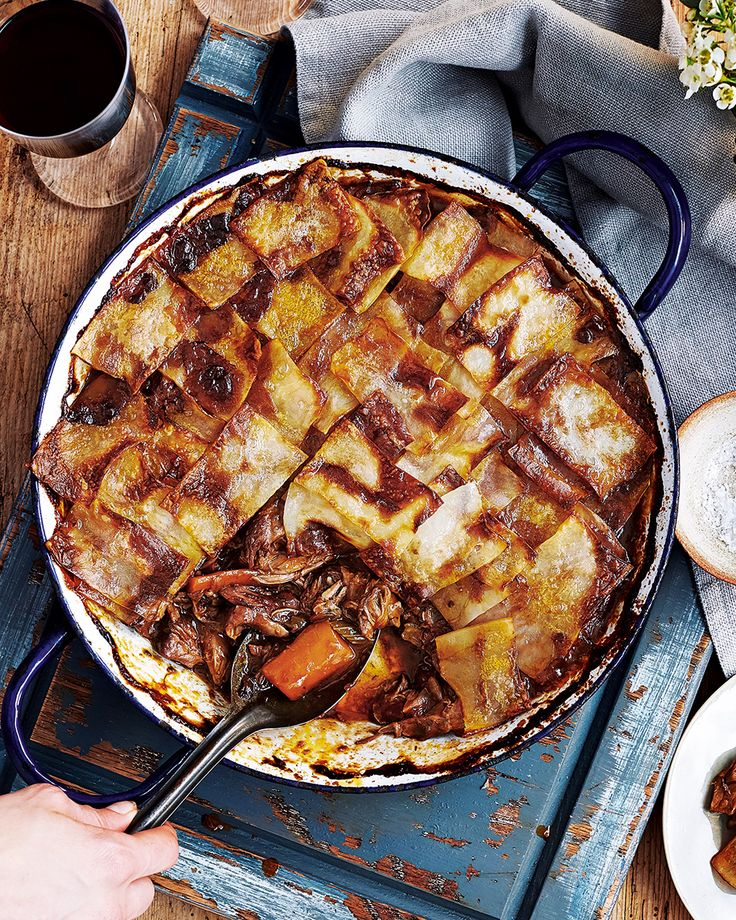 Swap the traditional roast for this slow-cooked hotpot. In this recipe lamb shanks are cooked until tender in red wine and then topped with crispy slices of potato – a guaranteed crowdpleaser.