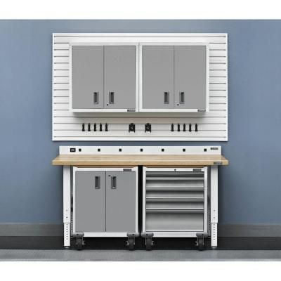 Gladiator Everest White from HD.  Didn't realize workbench metal can be white.  Probably prefer 6' so can have stool & space for my legs.  Not fan of cabinets over bench like that.
