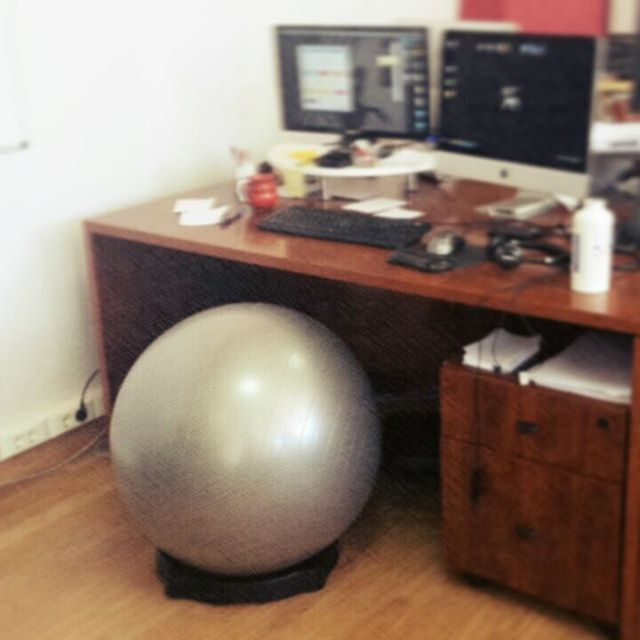 "We are constantly trying to improve our work space - can you guess who is testing out this round and comfy ""chair""?  #work #hubspider #ball #healthy #worklife #like #instamood #instacool #testing #motivation #office"