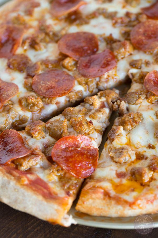 Spicy sausage and pepperoni pizza is so much better made at home than getting delivery! You'll thank me later!