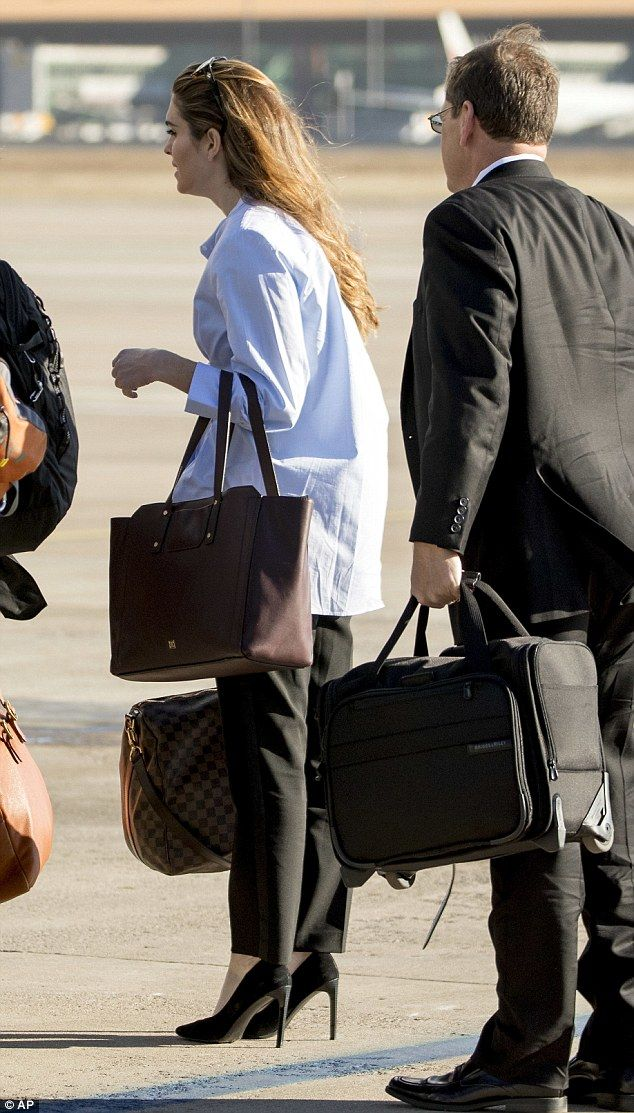Early flight? On November 10, 2017 Hope favored comfort over fashion when she wore a baggy men's shirt at the Beijing Airport in China, while carrying an Ivanka Trump tote and a $1,400 Louis Vuitton holdall