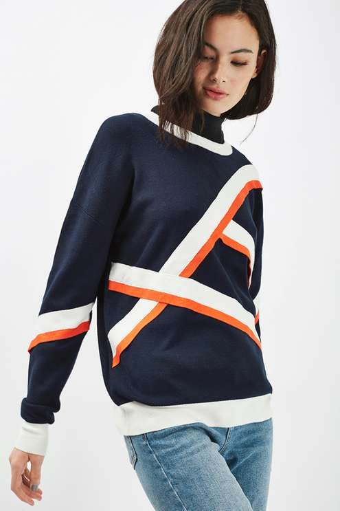 Invest in an eclectic style for your wardrobe in this mid weight long sleeve jumper in navy blue, with a cool contrasting print on the sleeves and body. A simple way to add character to your outfit, we love to wear with frayed jeans and ankle boots. #Topshop