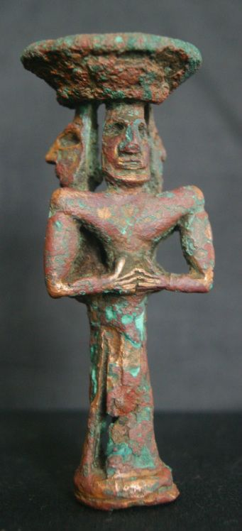 This is perhaps one of the most significant figures known from the Indus Valley region.  Statuettes in metal are extremely rare, and this depicts three god-like figures, each with prominent nose and wide muscular shoulders.  The function of the piece is unknown - it may depict a triumvirate of gods or possibly kings. Metal was a scarce and valued commodity in the Indus Valley, and was little used in art. The piece stands only 11.3 cm in height.