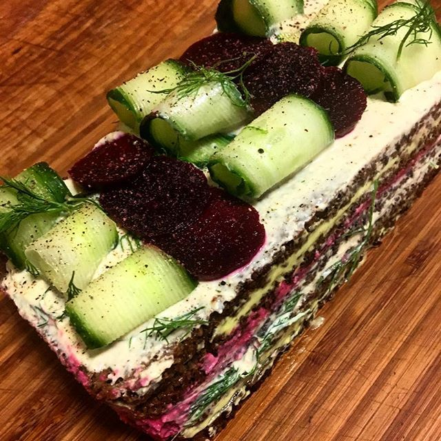 Today's #Veganuary special a #Smörgåstårta (savoury Swedish sandwich cake) Creamy avocado, tofu and dill pate & beetroot hummus all layered between pumpkin rye and topped with fresh dill, cucumber and beetroot, served with salad. #liverpoolcoffee #independentliverpool #liverpoolcoffeeshop #liverpoolfood #dogfriendlyliverpool #liverpooleats
