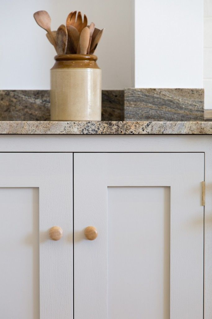 Sustainable Kitchens - Redland town house. Shaker style kitchen with oak cabinets painted in Farrow & Ball Purbeck Stone with an Australian Juperana Sandstone worktop.