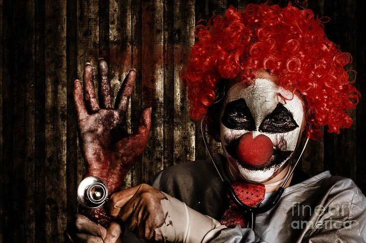 Frightening Clown Doctor Holding Amputated Hand  Photograph by Jorgo Photography - Wall Art Gallery
