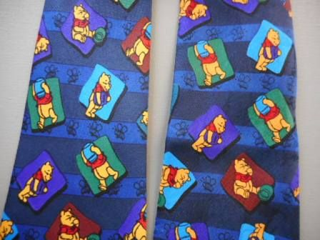One of these is a copyright Disney tie, the other is a cheap copy