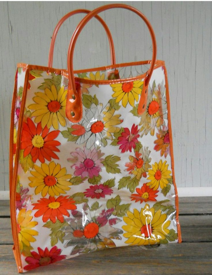 This orange, floral plastic tote was everywhere in the 70s!