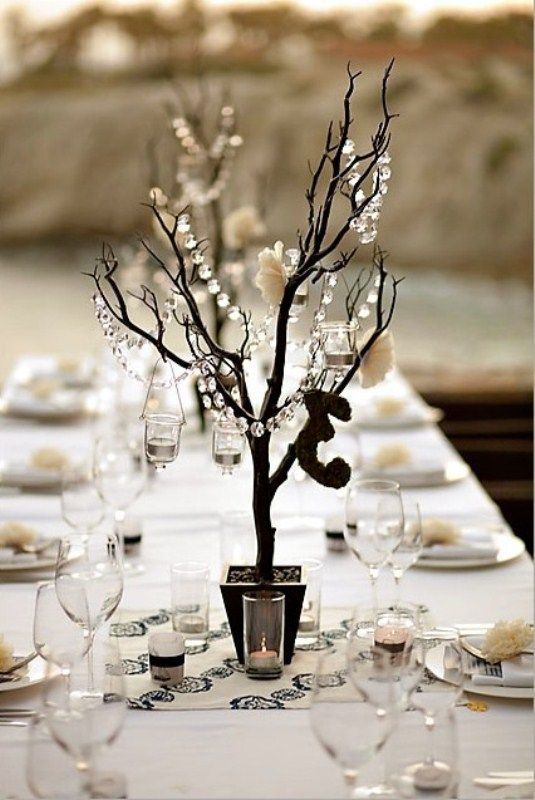 More along the lines in size . . . could still use the cylinder vase with fillers and could always spray paint branches.