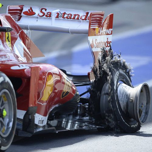 Attirant #F1 Ferrari Driver Felipe Massa Enters The Pit With A Puncture  During The British