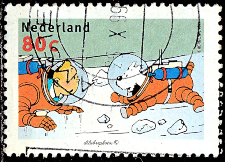 Netherlands.   Tintin.  Tintin, Snowy in space suits. Scott 1037 A393,  Issued 1999 Oct 8, Perf. 13 1/4x13 3/4, 80. /ldb.
