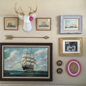 How great does The Alfred, our large white faux deer head w/gold antlers look on this gallery wall! Such unique pieces of art; we love it!