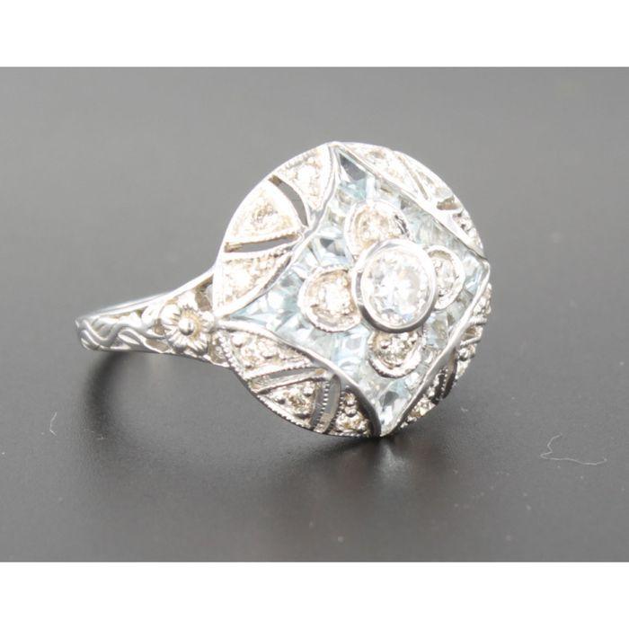 Online veilinghuis Catawiki: Witgouden ring met blauwe topaz en briljant geslepen diamanten