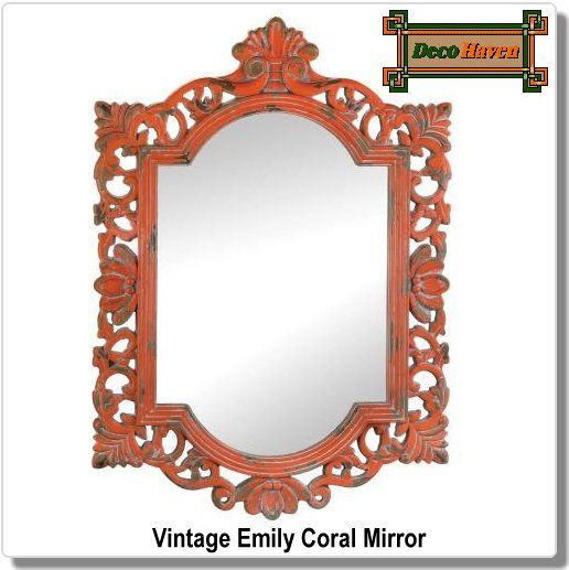 Vintage Emily Coral  Mirror - The elegance of a bygone era mixed with a weathered finish make this wall mirror an easy way to amp up the style in your room. The ornate wooden frame?s coral paint is perfectly worn to make it look like a vintage treasure. The color of this item may vary due to distressed finished.