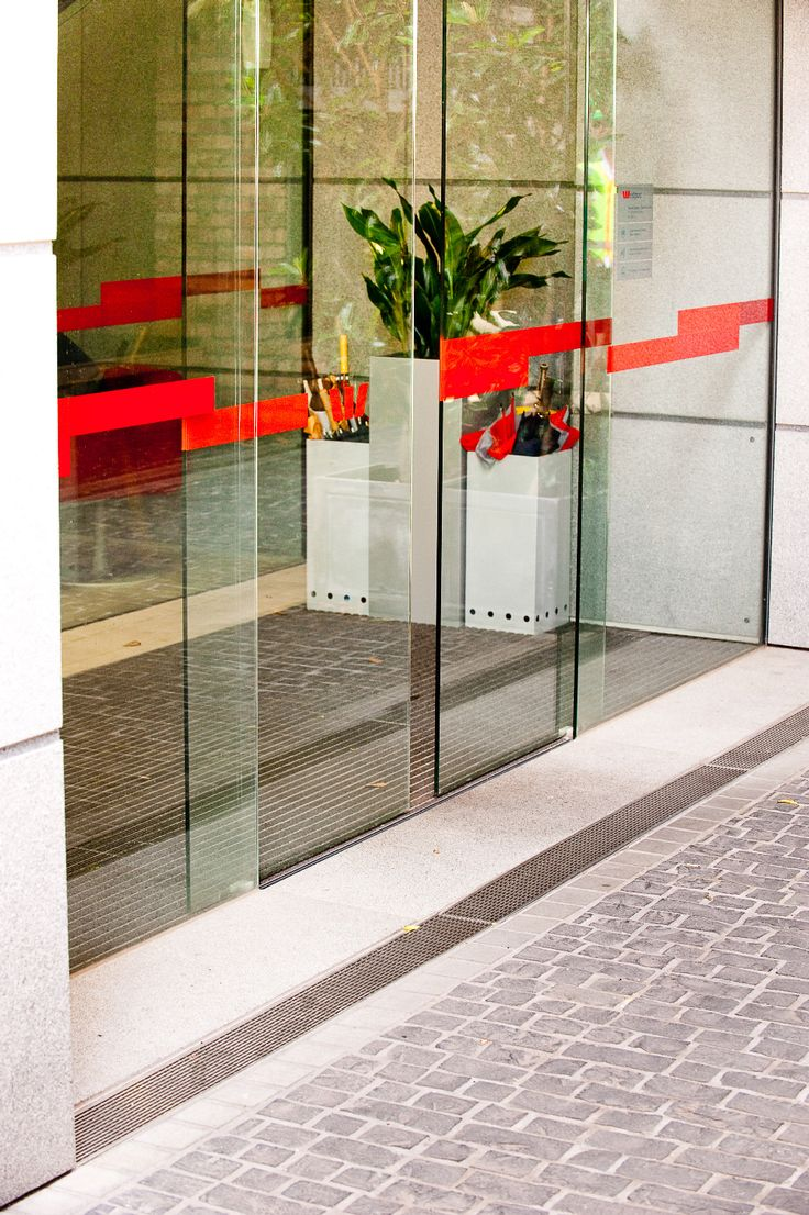 Level Threshold for corporate office doorway. Allproof Industries.