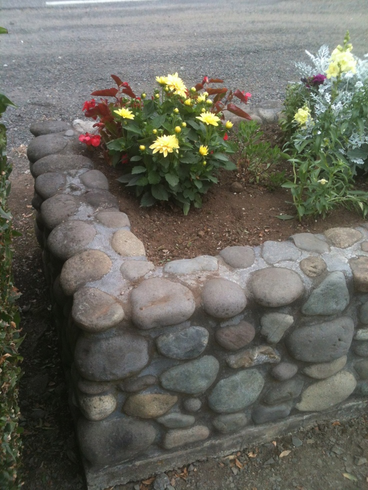 Raised garden bed made with stone