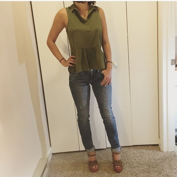 American Eagle Army Green Peplum Blouse This blouse from American Eagle is army green in color and features a collared neckline. Slightly sheer, this top is sexy whole still providing modesty. The peplum bottom or idea a perfect silhouette making this top a must have. Could dress down with jeans or up with a skirt and heels! Size Small. material composition pictured above.   ✨the lucky brand platform sandals and Amerixan Eagle Jeans are listed for sale in my closet! Bundle to save on the…