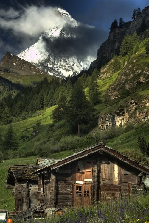 The cabin has seen better days, but that view would never get old! Definatly Alpine country, in Europe, I believe Sweden.