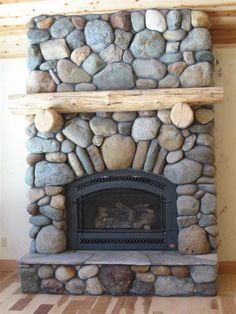river rock fireplace - I kind of like the big rocks for the dining room