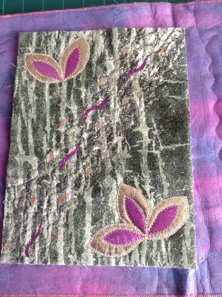 Painted bondaweb ironed onto fabric the Appliquéd miniature quilt