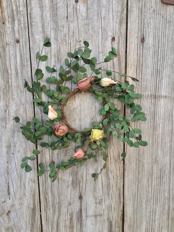 Boxwood mini wreath or candle ring with small bud flowers