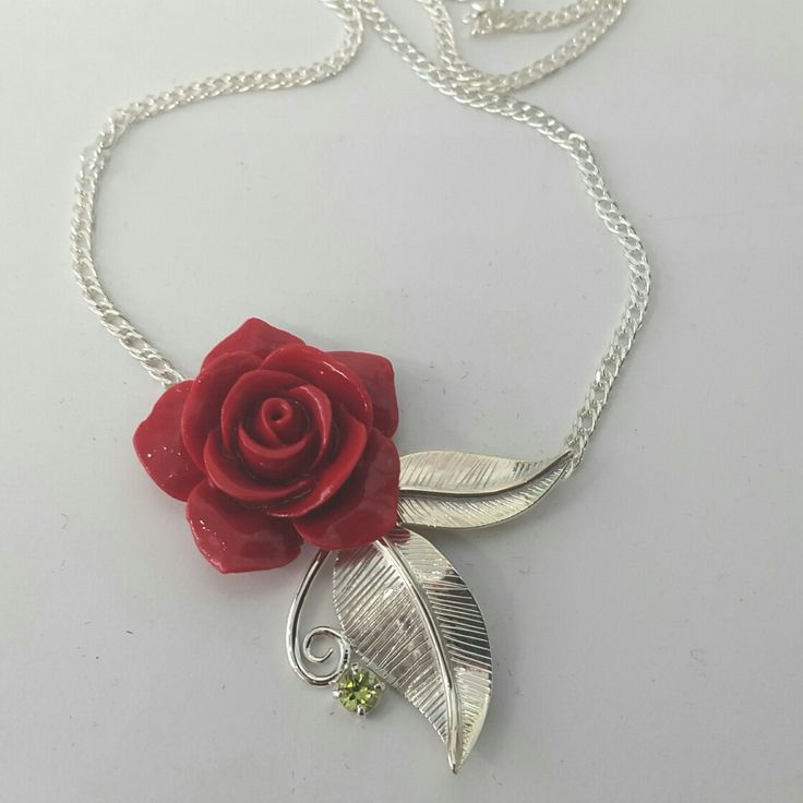 Adorned by sally  Red rose sterling silver and peridot pendant