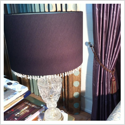 Coordinated Lamps and lampshades really set off a room, particularly on bedside tables.    Why not utilize a favourite lamp base and have us re-cover the shade in a coordinating fabric to your curtains?