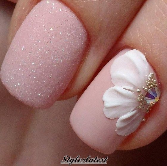 I like the pink sparkle nail.