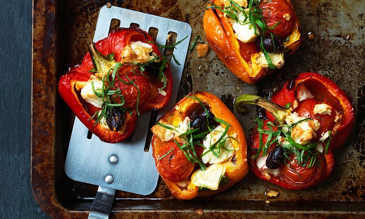 2 peppers, halved and deseeded (1 red and 1 yellow or orange) 12 cherry tomatoes 8 pitted black olives 50g feta cheese, crumbled 1 tsp olive oil 1 tsp fresh oregano Method  Preheat the oven to 200C/gas 6. Place the peppers on a baking tray, cut side up. Toss together the remaining ingredients and use to fill the peppers. Cook for 30 minutes until the peppers are tender.