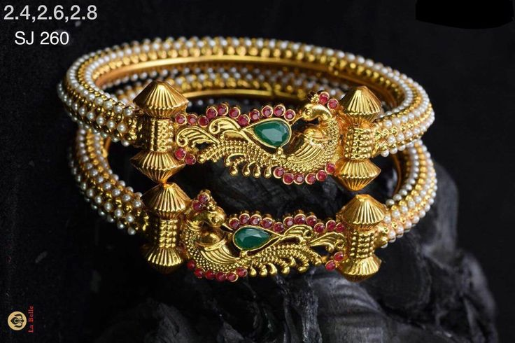 Beautiful bangles with peacock design. Bangles studded with white color beads. 07 September 2017.