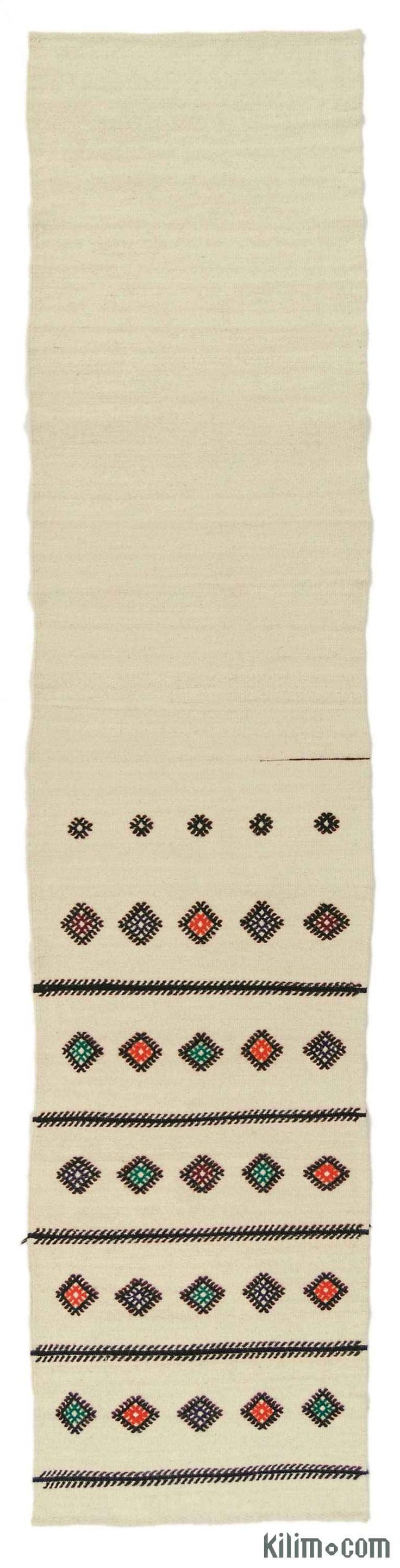 Vintage kilim runner rug handwoven in Turkey in 1960's. This tribal minimalist rug with jijim weavings is in very good condition.