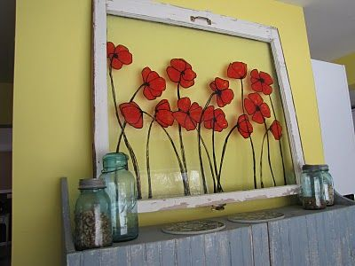 This has potential and could cheer up any corner of the home.  Fake stained glass on an old window...